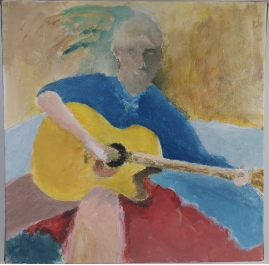 Seated boy with guitar